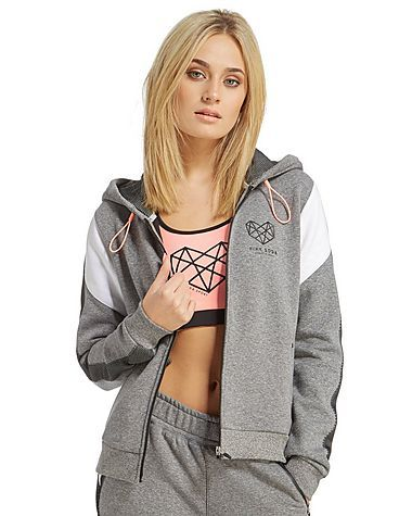Spotted on everyone from Vicky Pattison, Jorgie Porter and Ferne McCann, Pink Soda Sport is dedicated to positive body image and healthy living, made for women who want to look great at the gym and on the streets. This Panel Zip Through Hoody is a post-gym essential, perfect for chilling out in after a long session. Soft and snug thanks to the brushed back fleece interior, mesh panelling lets you cool down in comfort, while the heat sealed zip pockets and bungee adjustable hood give you…