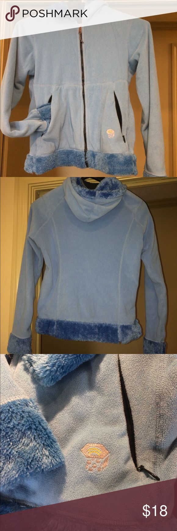Blue Fleece Zip Up Mountain Hard Ware Sweater All blue zip up fleece like sweater jacket by Mountain Hard Ware. This is like with a very warm fuzzy material and lines the trim on the outer part. This is warmer than a normal north face fleece. Has adjustable waist to keep out cold and a second layer at the wrists to also do the same. Both outer pockets zip shut. Comes from a smoke free home. Mountain Hard Wear Jackets & Coats