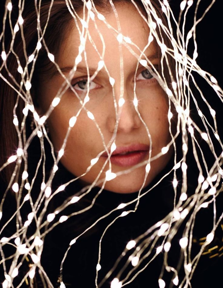 Lighting up the page, Laetitia Casta poses in a closely cropped shot