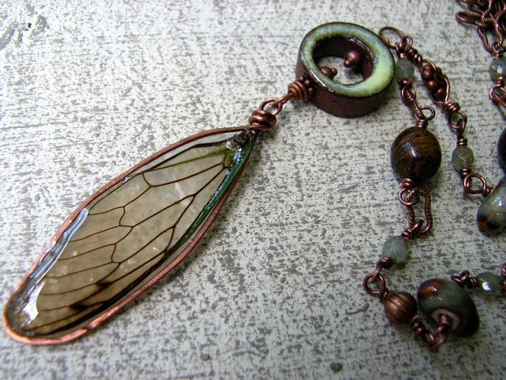 Cicada wing set in resin with ceramic beaded chain necklace