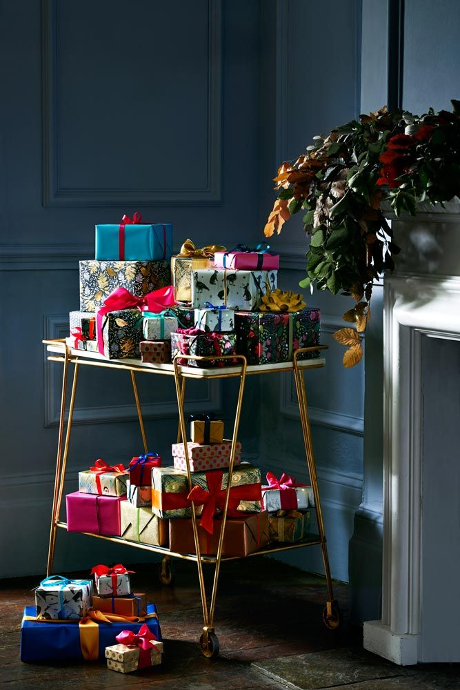 The tree has only so much room to tuck presents under – any more and they take over. So wheel in any excess on an art deco trolley, keeping them safe from pets…and tiny hands.