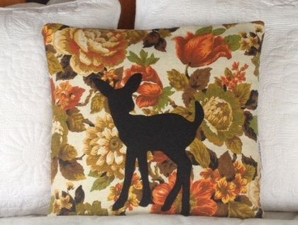 This is a stunning cushion made from an old vintage floral curtain with the cutest Bambi motif which is absolutely striking. It is an absolute perfect addition to your home decor.   The felt Bambi applique has been sewn on ever so carefully!!   It has an envelope fold opening and is cover only, meas...