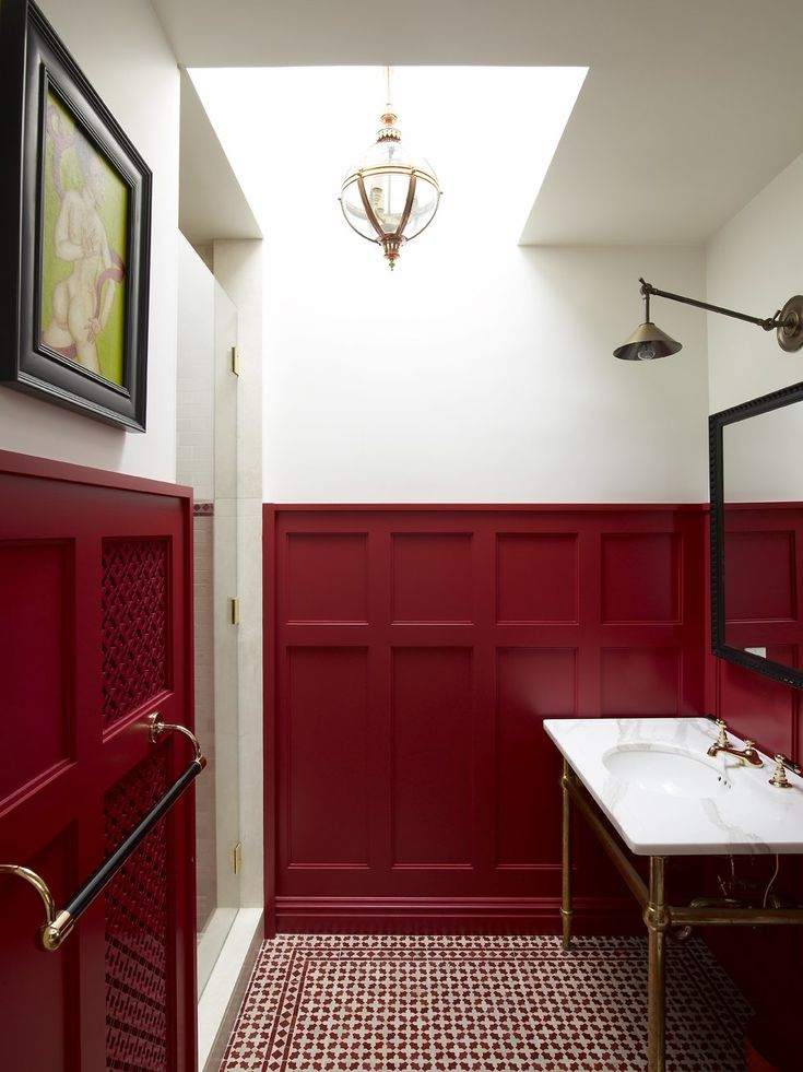 What an eye-catching powder room! The red wainscoting is dazzling and the  red and white tile is perfect, with a simple marble sink and brass hardware  this ...