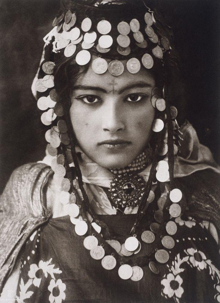 An Ouled Naïl girl wears a dowry of gold coins. Photograph by Rudolf Franz Lehnert (1878-1948) and Ernst Heinrich Landrock (1878-1966)