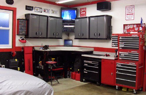 What a great garage design. Clean, functional and has a TV!