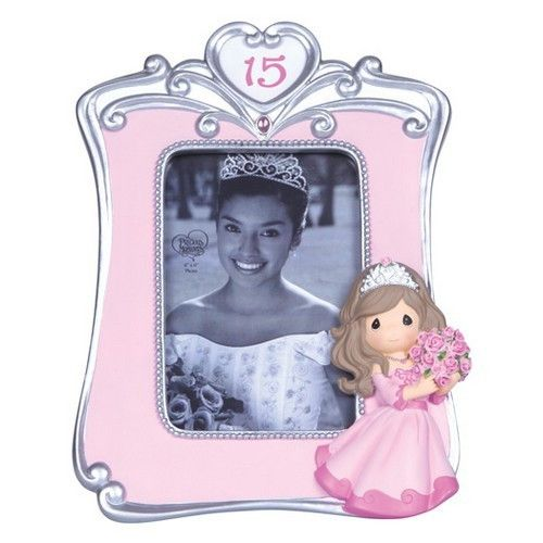 """The birthday girl is always a lovely sight when dressed in her quinceañera gown and tiara. Give her a gift that captures the moment forever. Our sleek and stylish pink and silver frame holds a 4"""" x 6"""""""