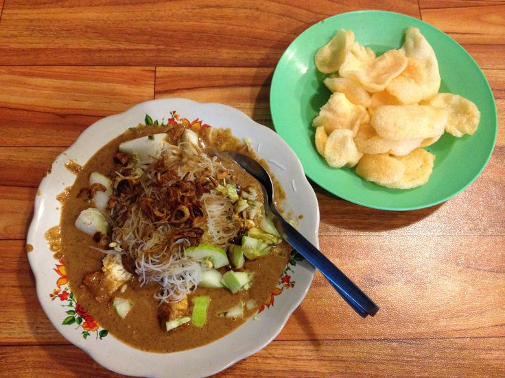 KETOPRAK. Betawi dish. Rice cake, tofu, beansprout, rice noodle, and cucumber served with thick and rich peanut souce and onion crackers.