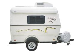 The Little Joe is a compact two wheel travel camper trailer. This lightweight camper is unique, well designed and is equipped with a sink, stove, seating area, bed, storage and awning.