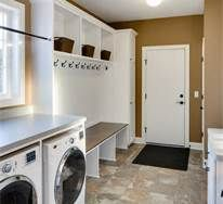 mud room laundry room combo - with toilet behind door on right. sink, right foreground.