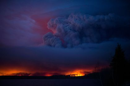 A massive wildfire, which caused a mandatory evacuation, rages south of Fort McMurray