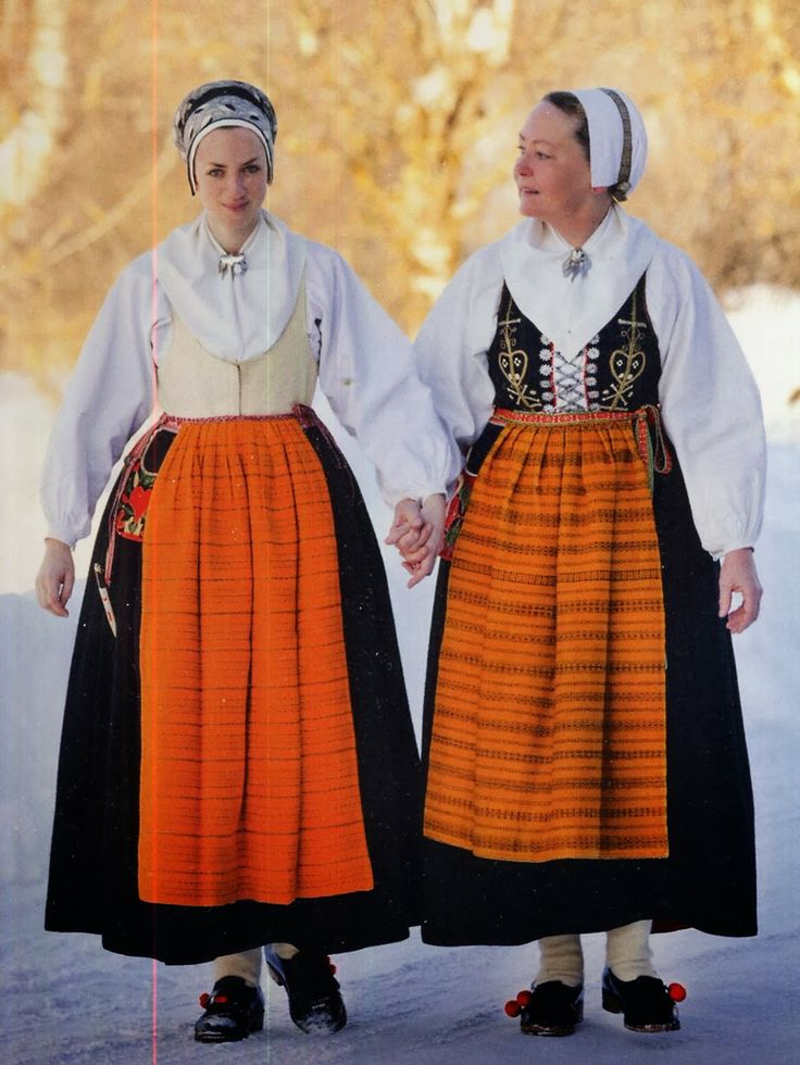 Leksand Dalarna Sweden - Sometimes in colder weather, bodices made from leather are worn. These are made with the same kind of chamois leather as is used for the men's breeches. They are also sometimes embroidered in the same way, in which case they are called laskat. They hook closed so as to be warmer.