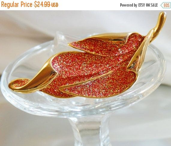 This #vintage red glittery leaf brooch is gorgeous!  It features a gold plated curled leaf with a beautiful red and gold glittery body.   Rolling C-clasp closure.    A perfe... #ecochic #etsy #jewelry #jewellery