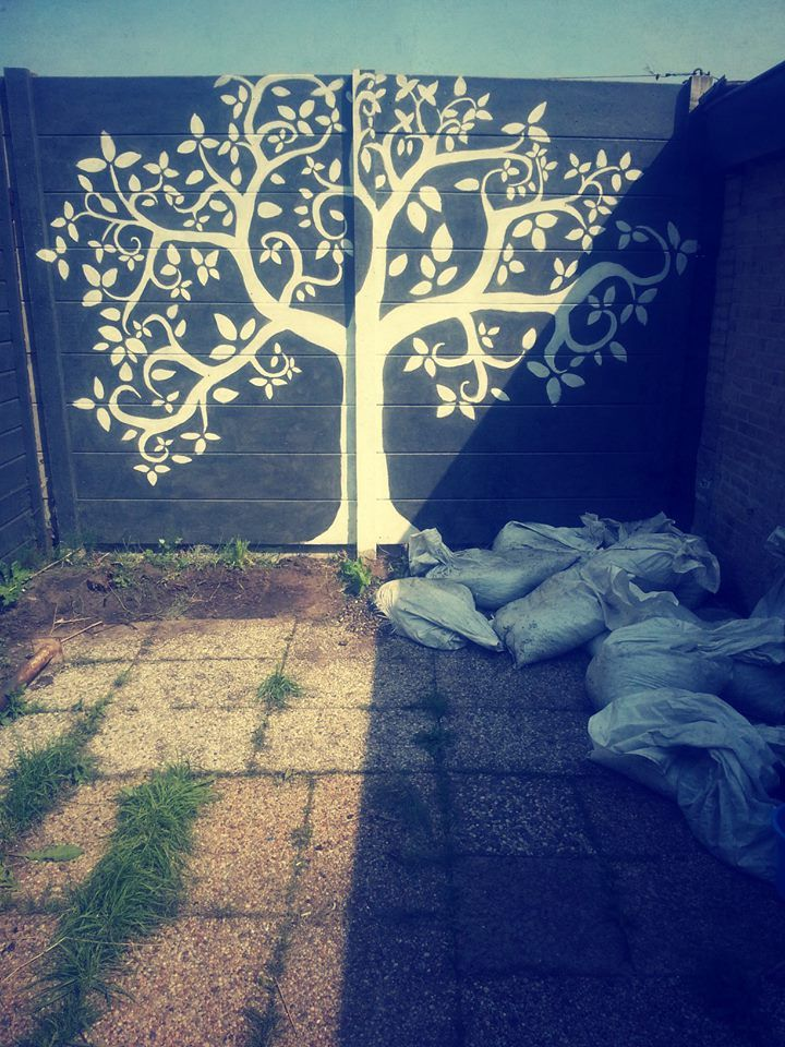 painted concrete wall, garden.