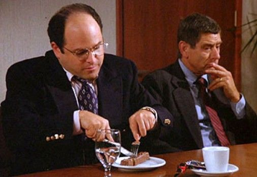 Classical - George Costanza eating a Snickers with knife and fork in Seinfeld
