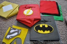 Free super hero printable templates. She also has a super cute and easy tutorial for DIY super hero bins.