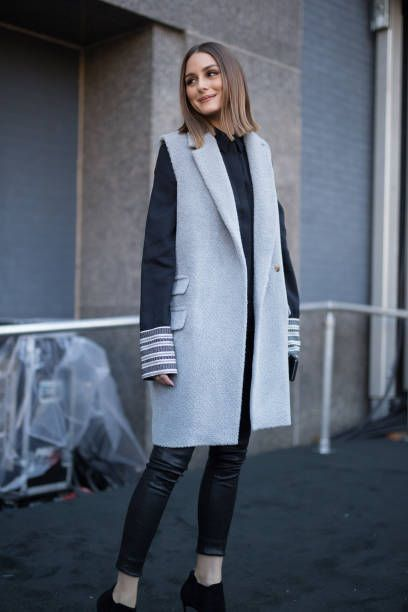 Olivia Palermo is seen on the street attending Colovos and Noon By Noor during New York Fashion Week wearing a long grey wool vest on February 8, 2018 in New York City.