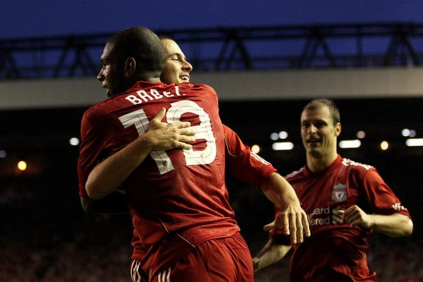 Ryan Babel of Liverpool celebrates with team mates Joe Cole, and Milan Jovanovic after he scores the first goal of the game during the UEFA Europa League play-off first leg match beteween Liverpool and Trabzonspor at Anfield on August 19, 2010 in Liverpool, England. - 16 of 46