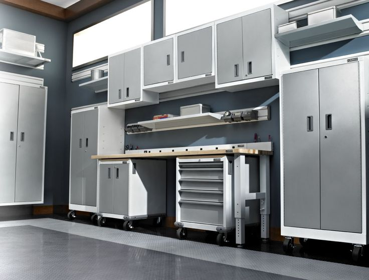 Gladiator® Everest White cabinets, workbench with modular cabinets docked underneath, GearWall® channel and metal shelves.