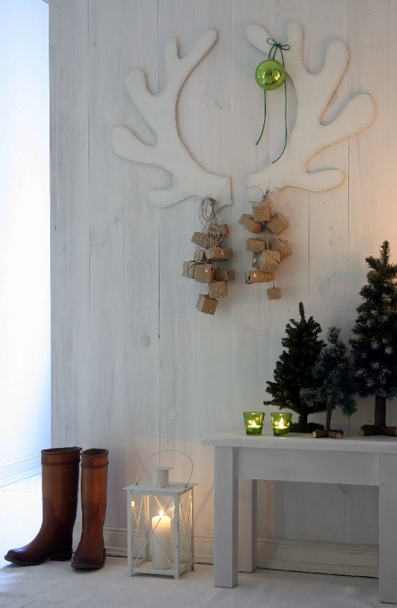 """I really like the idea of cutting some """"reindeer"""" antlers out of cardboard  and hanging some ornaments or gifts from them!"""