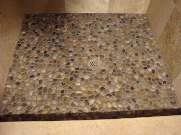 Smooth stone shower floor add on ideas pinterest for Pebble rock flooring diy