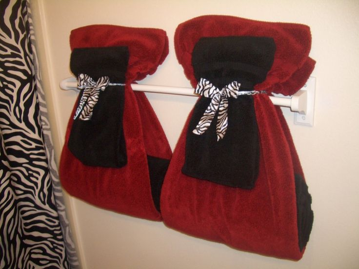 maybe add some red towels and red fake flowers since he likes red and im stealing his bathroom.. ;)