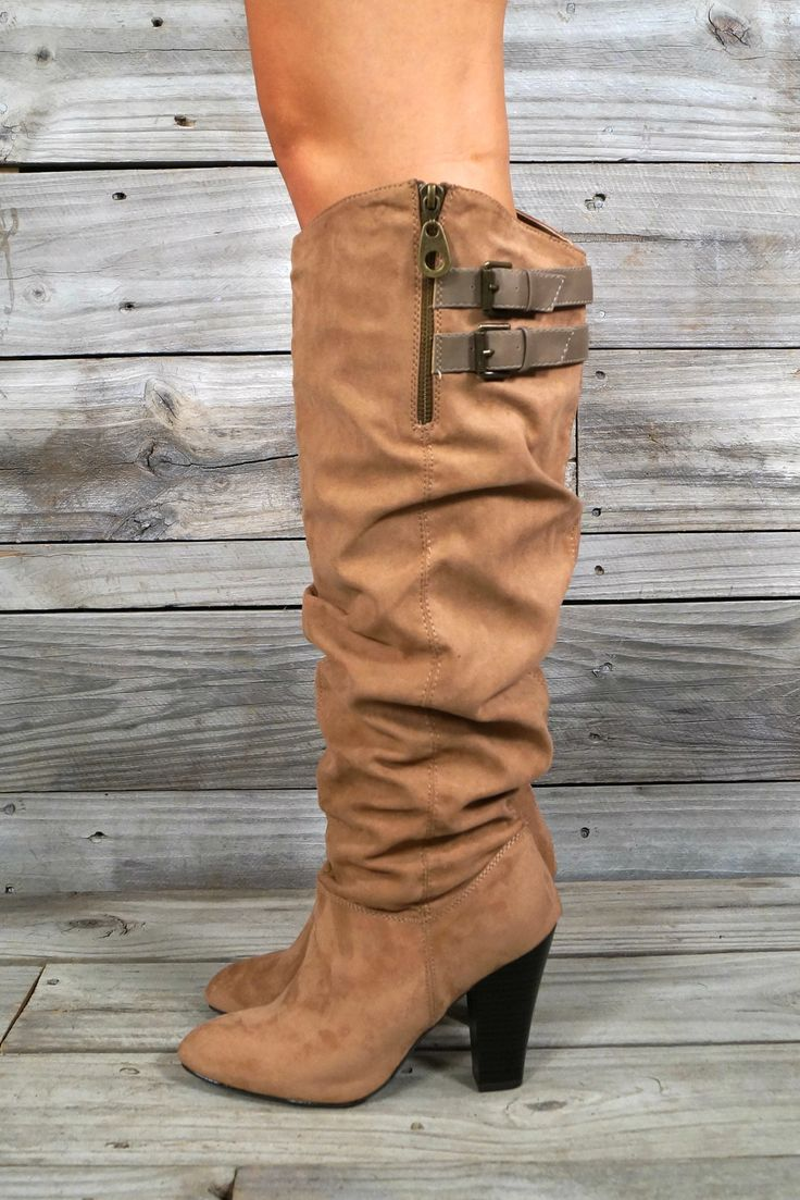 Madge Boots: These tall brown suede slouchy boots have two buckles at the top that are taupe colored with brass buckles. The top also has a zipper that goes down 4.5 inches. The heel on the boot is 3 inches.