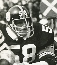 Candid black and white photograph of Lambert during a game wearing a #58 Pittsburgh Steelers uniform