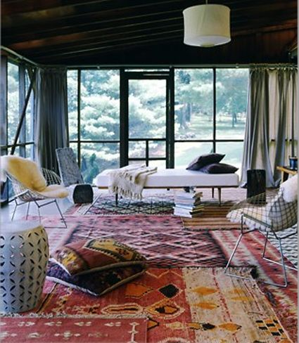 Porch Decorating Layered Rugs On A That Never Gets Any Rain Add Windows To Keep From Getting Ruined Domino Magazine