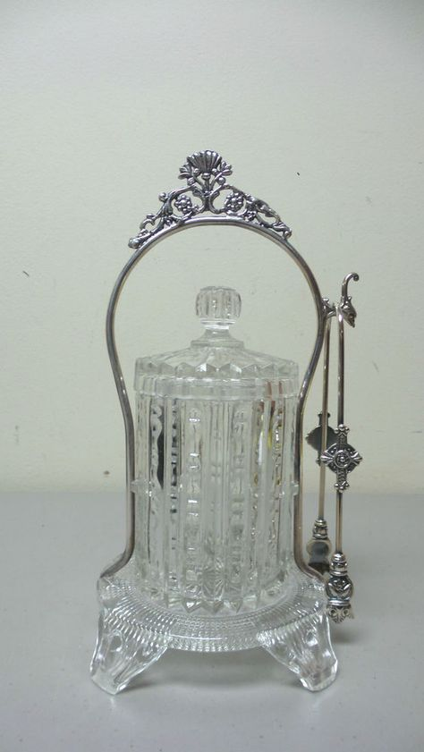 UNUSUAL EARLY AMERICAN PATTERN GLASS PICKLE CASTOR, SILVER PLATE STAND