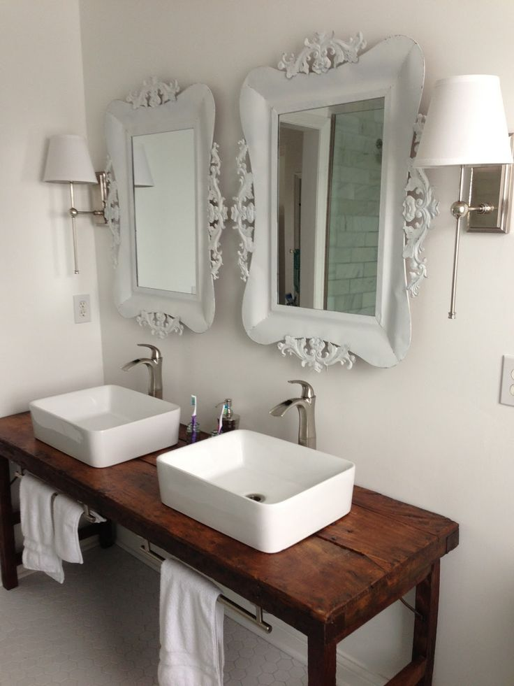 White bathroom with vessel sinks and wood table as vanity Like the ...