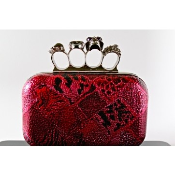 Printed Leather Clutch with 4-finger Grip and Skull Closure, $70      Rings and a bag? If that's not maximizing your accessories, I don't know what is.