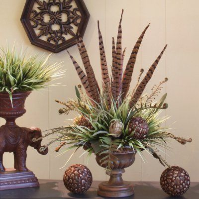 Add an exotic flair to your home's decor with our gorgeous design of pheasant feathers, feather balls and artichokes with fern fronds set in a resin vase.
