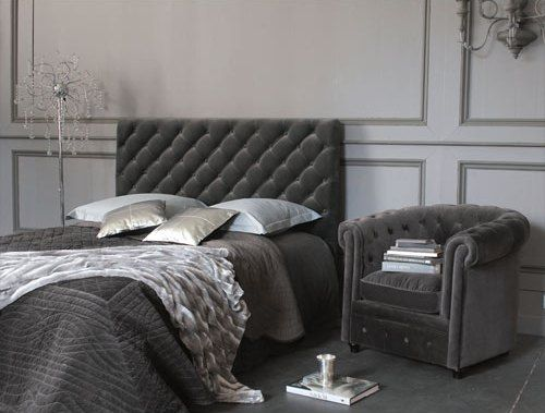 Grey velvet tufted headboard and a matching chair. Just beautiful!