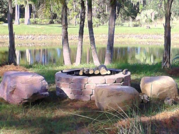 Backyard Getaway firepit featured in article on hgtvgardens.com. Boulders offer natural seating solutions around a fire pit created by  Backyard Getaway , a Florida company.