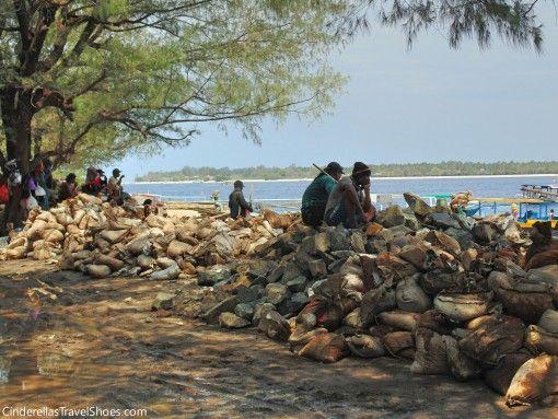 Locals are having break during work in the harbor of Gili Trawangan