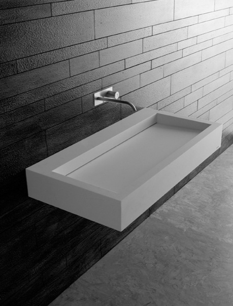 Slot, sink in Corian wall mounted with incorporated siphon by Antonio Lupi _