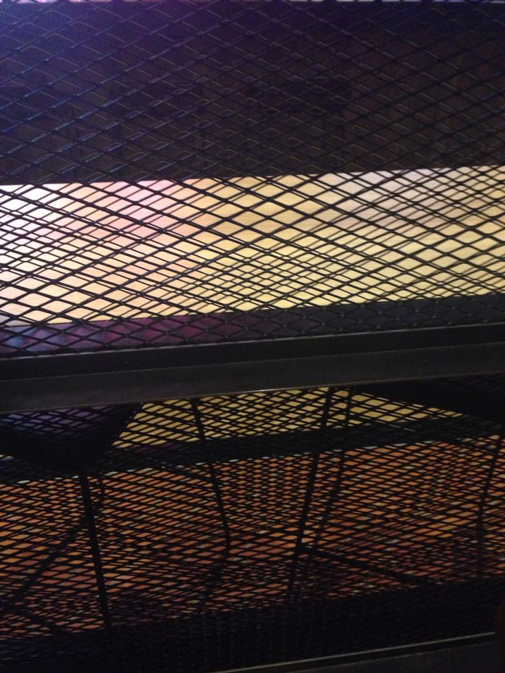 PHOTO 7: Closer look at steel and wire mesh dividers at San Antone restaurant