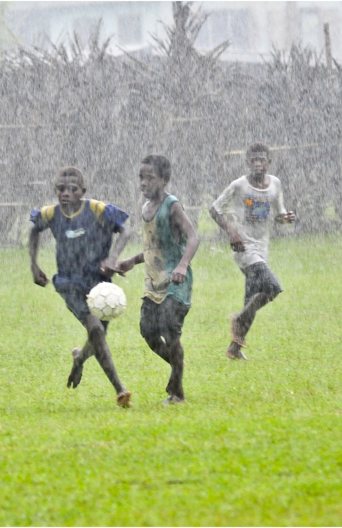 Some kids playing soccer in Vanuatu.