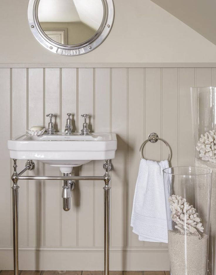 Sandy tones and influences take this neutral bathroom to a seaside location without all the obvious blue and white nautical touches. Carefully chosen accessories introduce the trend while retaining a calming neutral tone - perfect for a relaxing bathroom.