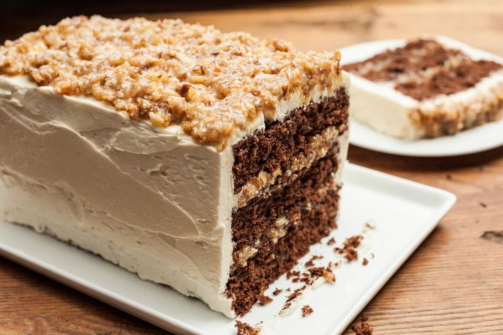 A German chocolate cake recipe made with layers of sweet chocolate cake, toasted coconut, and nuts topped with a light vanilla buttercream.