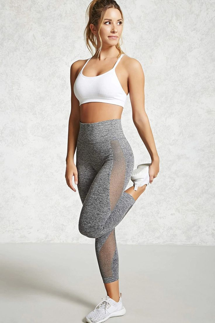An athletic pair of marled stretch knit capri leggings featuring open-knit mesh panels along the leg, moisture management, and an elasticized high-waist.