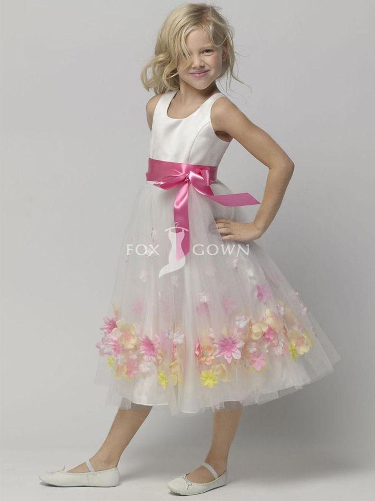 white sleeveless a-line tea-length flower girl dress with fuschia ribbon sash and flower at skirt