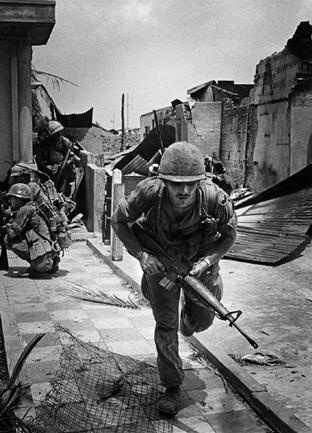 US 9th Division soldier during fighting in Saigon, South Vietnam: 1968. (Philip Jones Griffiths)