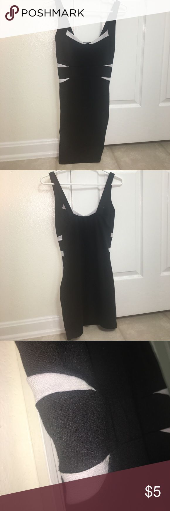 Black & White Club Dress Short black dress with white accents! Super stretchy material for a great body hugging look! Forever 21 Dresses Mini