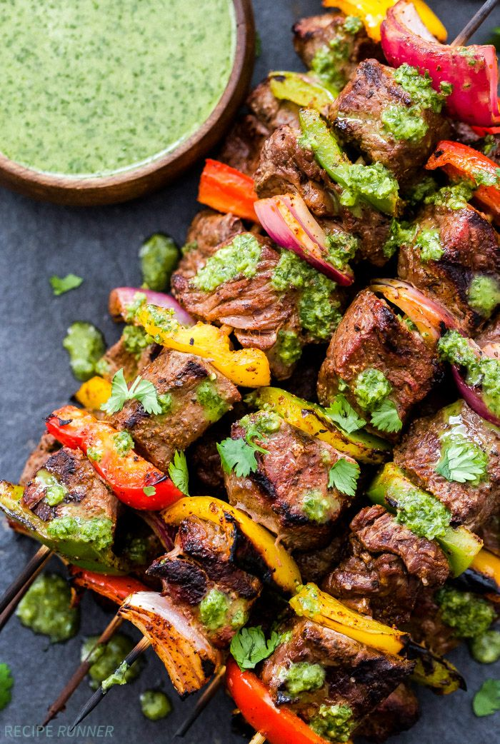 Steak Fajita Skewers with Cilantro Chimichurri are perfect for summer grilling! Big, juicy pieces of steak, sweet bell peppers and red onion all topped with an amazing cilantro chimichurri sauce. Healthy grilling never looked so good!