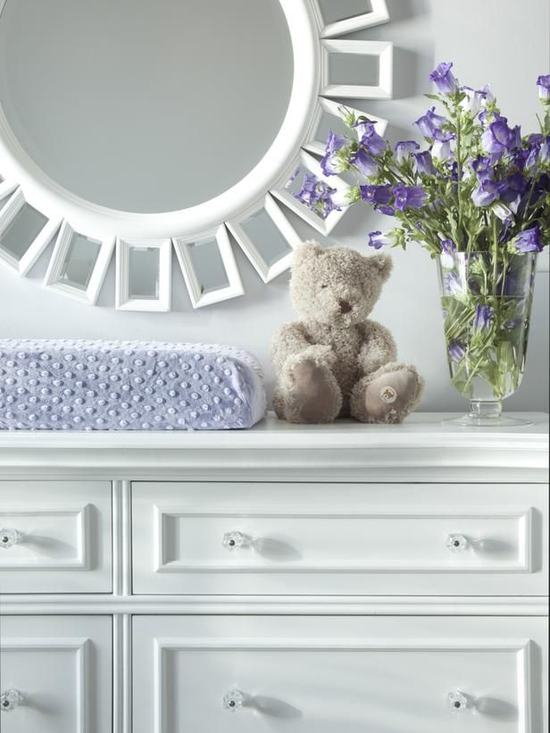 Bold crisp white dresser made into a changing table during infant year.  Transitional furniture. White Graphic Furniture - Small Urban Nursery Makeover on HGTV