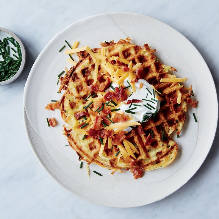 These best-ever loaded potato waffles get flavor from cheddar, bacon, sour cream and chives. Get the recipe at Food & Wine.
