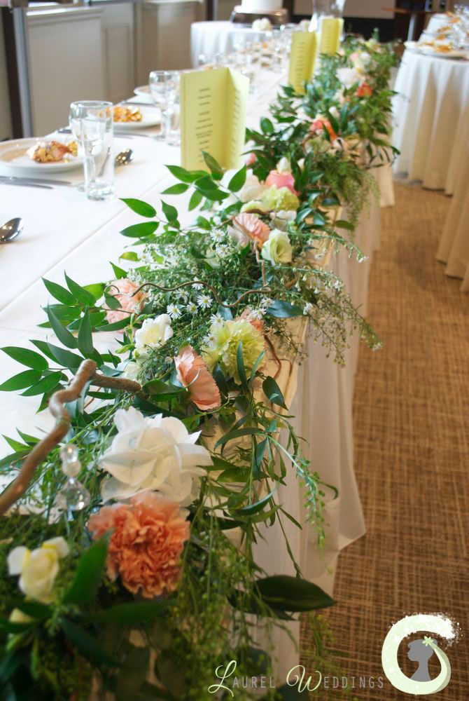 Top Table Garland With Twisted Hazel Branches, Mixed Greenery And Flowers.  Peach, Coral And Green Wedding Flowers   Laurel Weddings