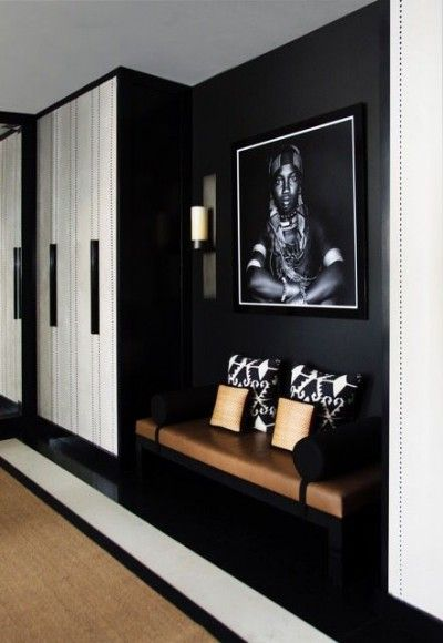 For added energy in a hallway, incorporate a visually striking art piece and patterned cushions atop a bench seat. Find more inspiration on Design Field Notes. #FieldNotes #DesignScheme #InteriorDesign #InteriorStyling #Art