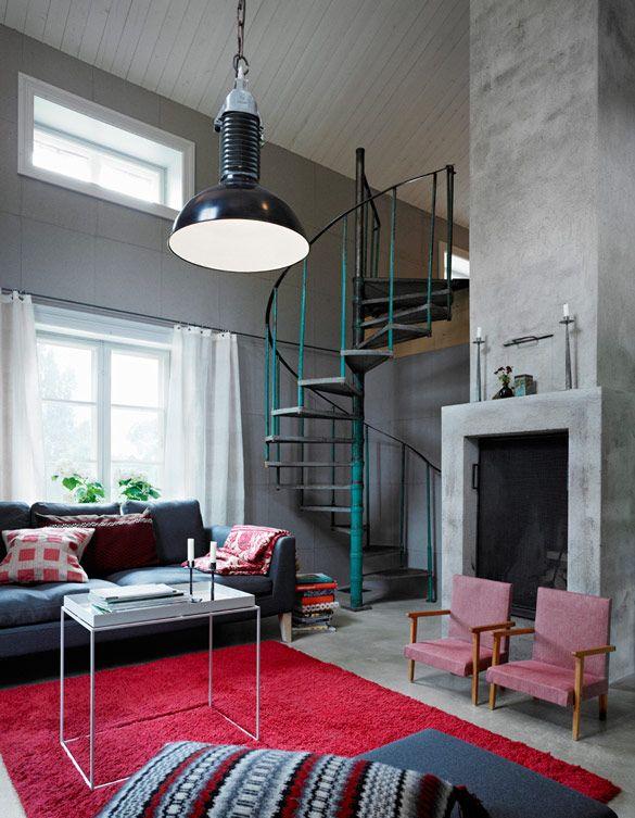 rectangular fireplace, industrial spiral staircase  huge pendant light